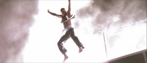 John McClane leaps in Die Hard.